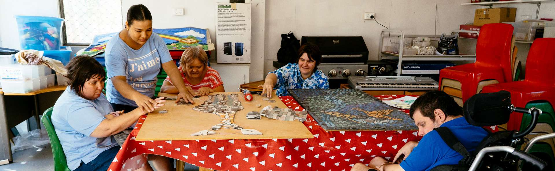 Adult Day Service clients enjoy a mosaic art and craft activity