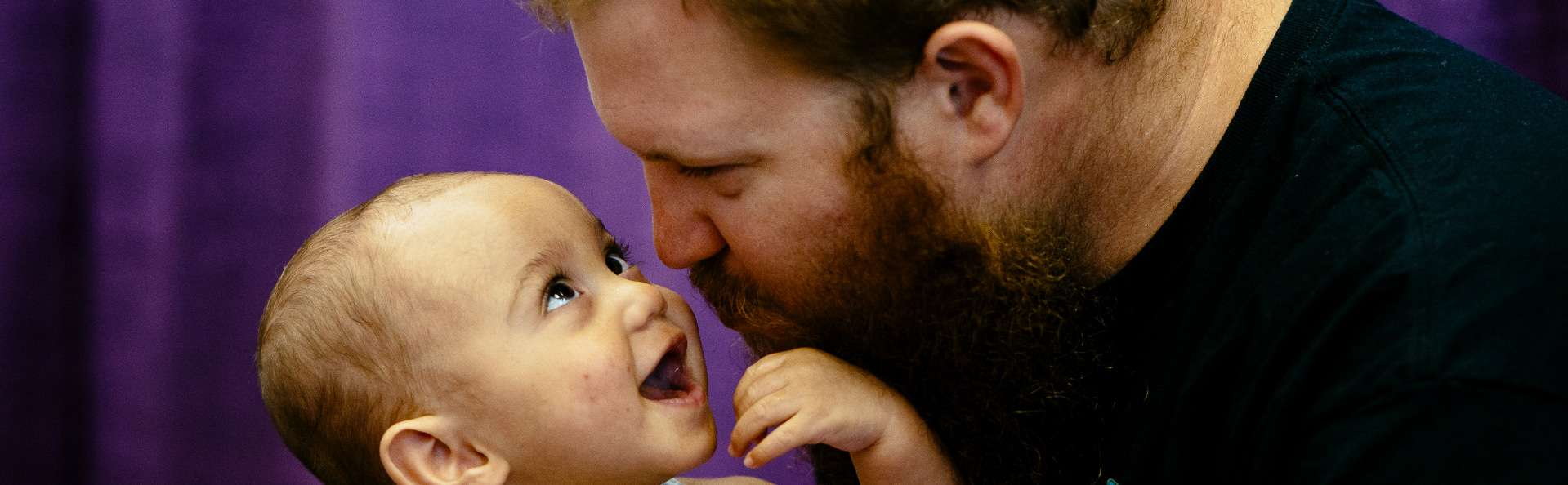 Baby and father enjoy their connection during a therapy session