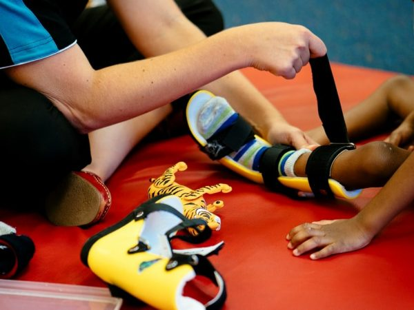 Occupational Therapist assists child with leg splints